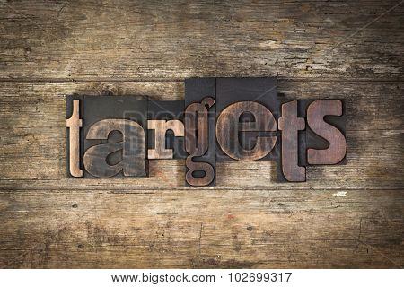 targets, set with vintage letterpress printing blocks on wooden background