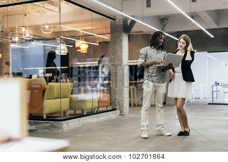 Coworkers Talking In A Modern Office