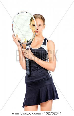 Portrait of a girl tennis player holding her racket. Studio shot. Isolated over white.