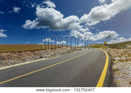 Driving On Alpine Asphalt Road At Sunshine Day