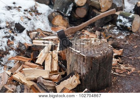 Axe And The Split Firewood.