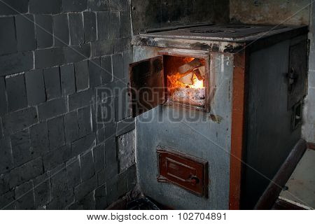 Old Rural Wood Stove With The Burning Firewood