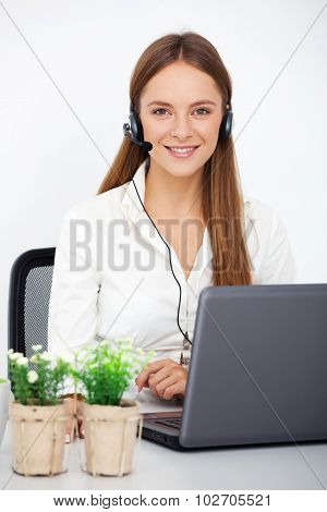 Portrait Of Happy Young Support Phone Operator With Headset.