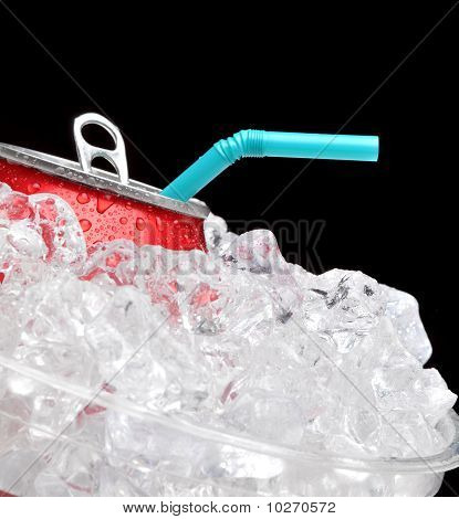 Soda Can In Ice With Straw