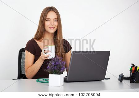 Portrait Of Young Business Woman Working At Her Office.