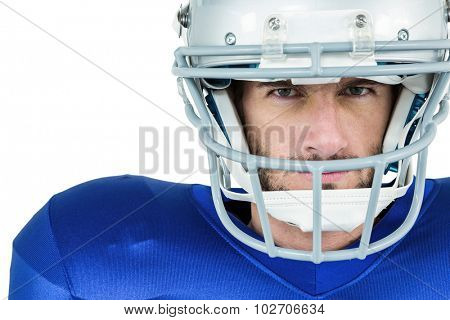 Portrait of stern American football player against white background