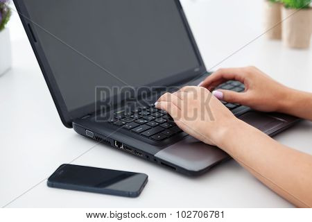 Closeup Of Woman Hands Working With Laptop.