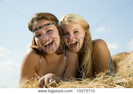 Country Girls Laying On Hay