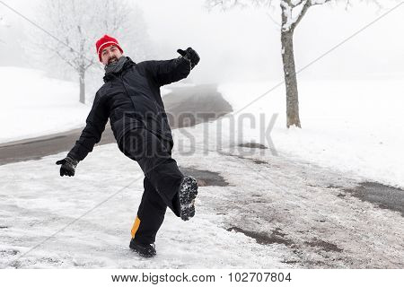 Man Is Slipping On A Icy Road