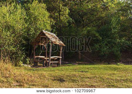 Wooden gazebo in park, early fall