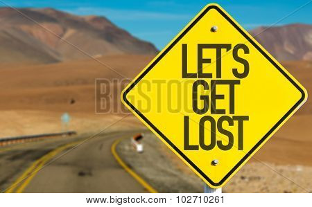 Lets Get Lost sign on desert road