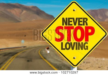 Never Stop Loving sign on desert road