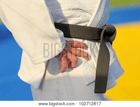 Detail Of A Black Belt And White Kimono
