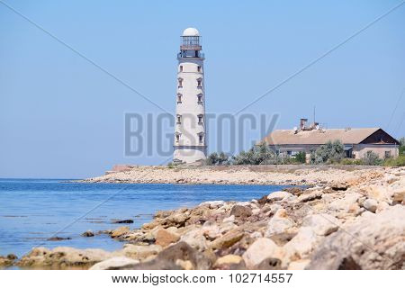 Sea landscape with the image of a lighthouse