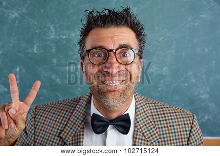 Nerd silly retro man teacher with braces funny expression winner victory finger gesture