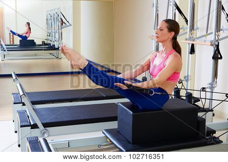 Pilates reformer woman short box teaser exercise workout at gym indoor