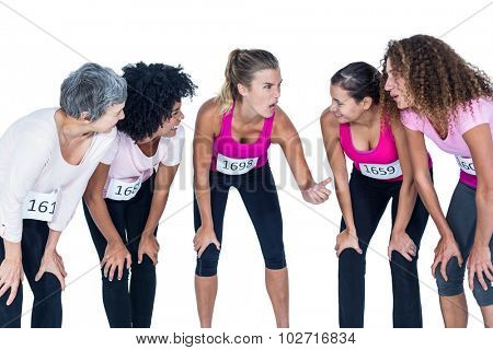 Smiling athletes gesturing and bending while standing against white background