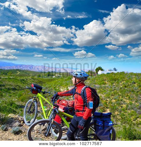 cycling tourist MTB cyclist in Pedralba Valencia with panniers and saddlebag Spain