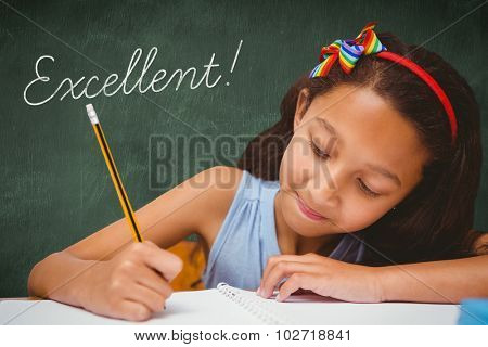 The word excellent! and pupil writing against green chalkboard