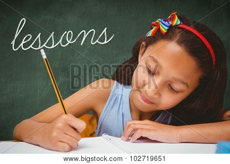 The word lessons and pupil writing against green chalkboard