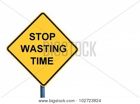 Yellow Roadsign With Stop Wasting Time Message