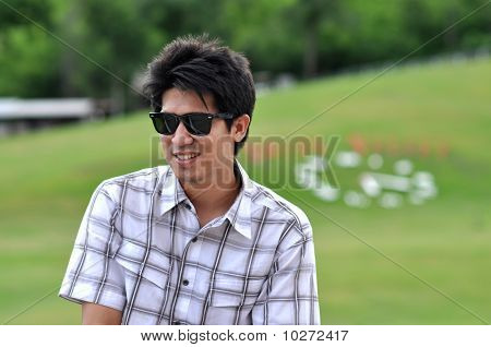 Asia Thailand Man Sit Smile  Sunglasses