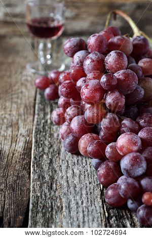 Bunch Of Red Grapes And Wineglass