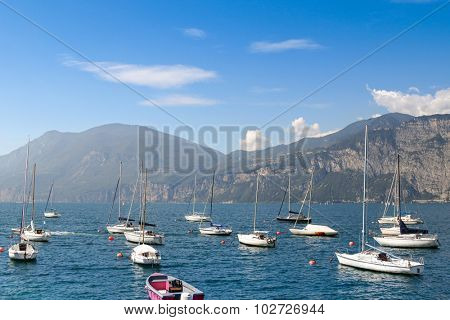 LAKE GARDA, ITALY - SEPTEMBER 2014 : Sailboats on The Garda Lake (Lago di Garda) in Italy on September 13, 2014. Lake Garda is the largest lake in Italya and one of popular places in the summer.