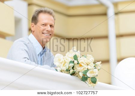 Nice man standing near handrail