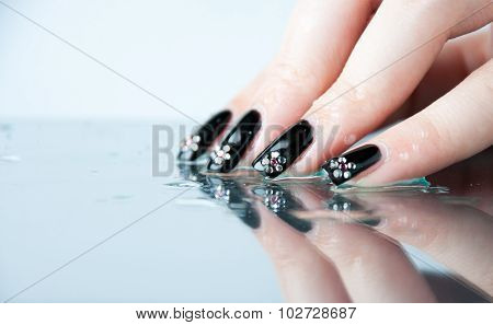 Hand with nail art and manicure