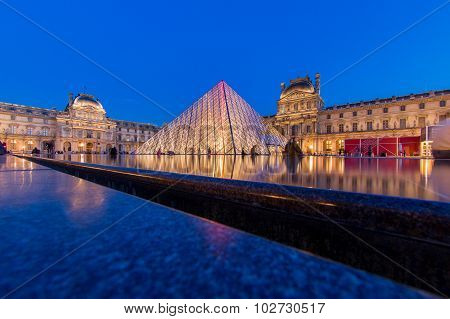 PARIS - AUG 15 : Louvre museum at twilight in summer on August 15,2013. Louvre museum is one of the