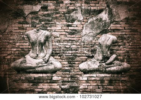 Old Broken Buddha Statue On Grunge Brick Wall Background With Vintage And Vignette Tone