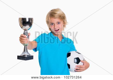Boy With Soccer Ball And Cup In Front Of White Background