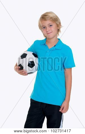 Boy With Soccer Ball In Front Of White Background