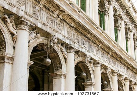 VENICE, ITALY - SEPTEMBER 2014 : Shallow depth of field of Arcades at St Mark's Square (Piazza San Marco) in Venice, Italy on September 15, 2014. Building is decorated with many lion heads statues