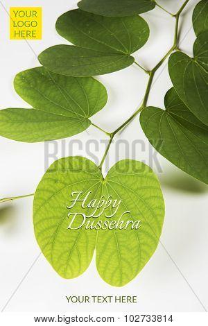 indian festival dussehra, showing golden leaf or Bauhinia racemosa leaf, greeting card