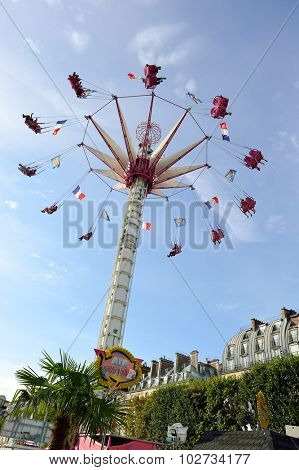 PARIS, FRANCE - AUGUST 09, 2015: amusement park near Louvre. Amusement parks evolved from European fairs and pleasure gardens, which were created for people's recreation