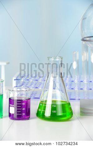Laboratory glassware on white table in lab