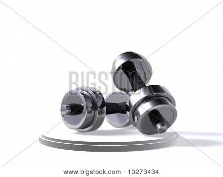 A Set Of Dumbbells On White Background