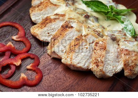 appetizing baked pieces of pork in mushroom sauce with cream