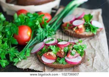Italian Tomato Bruschetta With Chopped Vegetables, Herbs And Oil On Grilled Or Toasted Crusty Ciabat