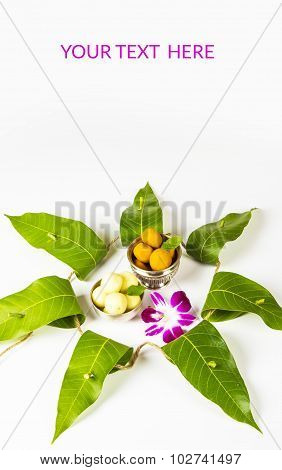 garland of mango leaves with indian sweet pedha and orchid flower . It is auspicious in hindu religi