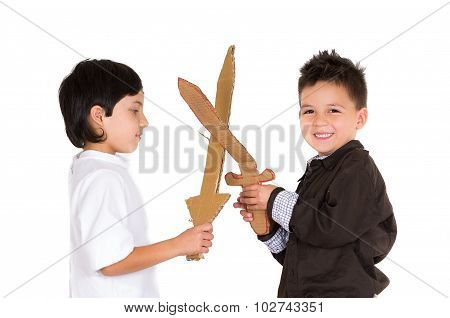 Two small boys simluating sword fight using toys and homemade shield, white background