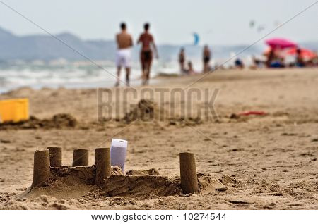 Sand castles and tourists on the beach