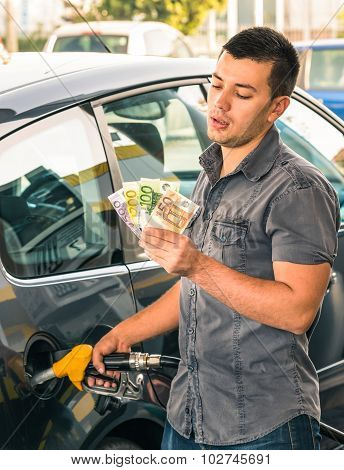 Man At Gasoline Station - Troubles Dealing With Money For Rising Gas Prices