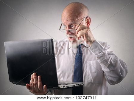 Businessman staring at his laptop