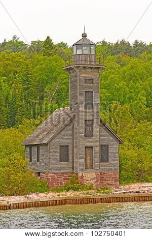 Abandoned Lighthouse On A Lonely Shore
