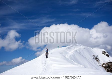Skiers walking uphill for freeride, extreme sport