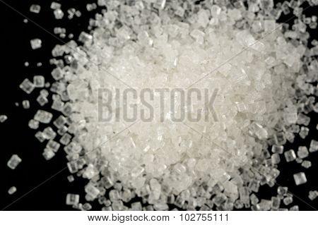 White Sugar On Black Background Macro