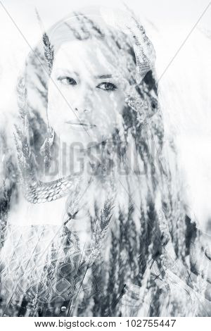beautiful long hair brunette woman portrait, double exposure with blades of grass